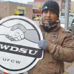 Bernando Morales shows his support for the RWDSU union, which workers have voted to join.