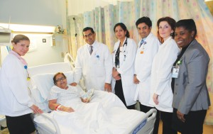 Some members of the Palliative Care team attend to patient Virginia Ramirez. Left to right: Ileana de Jesus, Medical Surgical Technician; Drs. Abdul Mondul, Puneeta Sharma and Vipul Shah; Ana Krokowski, RN; and Rev. Emilia Steele.