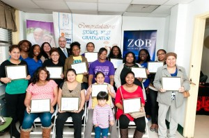 Stork's Nest participants celebrate the conclusion of their program at Union Community Health Center with members of the Zeta Phi Beta Sorority and State Senator Gustavo Rivera.