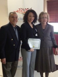 Jennifer Fernández, studying economics and dance at Queens College, receives her award.
