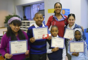 Union Community Health Center's Dr. Clark Adjo celebrates with pediatric patients who were honored for achieving academic goals. Dr. Clark Adjo