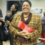 Anna Vicenty, Community Liaison, Congressman Serrano's Office, kept a piece of the ribbon for the Member's office.