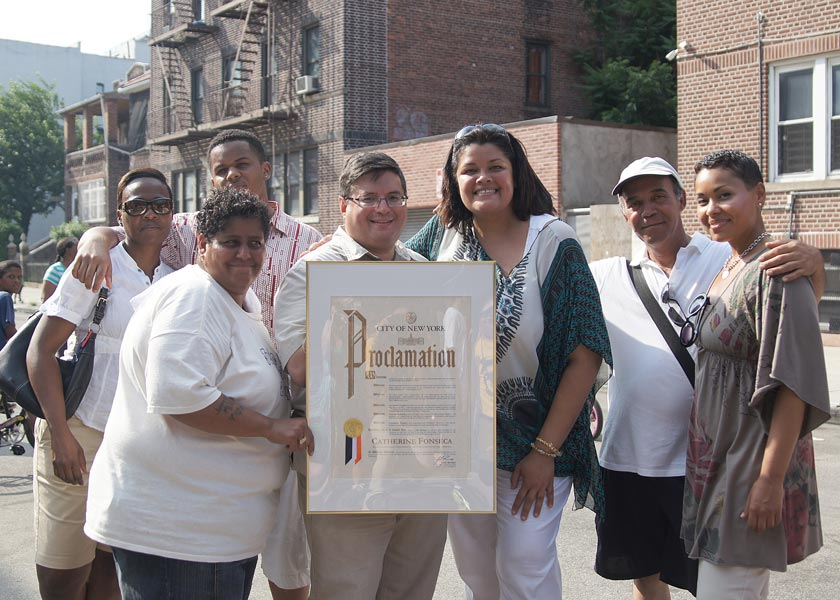 Photographer Catherine Fonseca (center) was honored for her work with a proclamation.