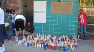 A memorial for 14-year-old Shaaliver Douse was placed outside of his family's building. <i>Photo: R. Kilmer</i>