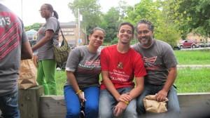 Bronx family members Jose, Ileanette Morales and their son, Bobby Romeu (center) enjoyed the work.