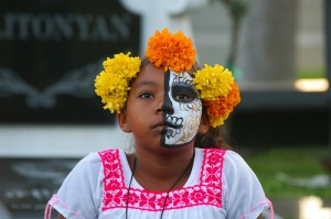 Children can get their faces painted like calaveras.