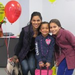 """Madelín Barrientos and her daughters, Alana Cosme and Julianne Sisto, enjoyed the """"Let's Bloom"""" festival at CUNY in the Heights."""