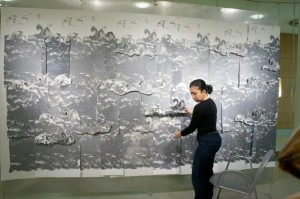 """I am my own history,"" says artist Scherezade García, standing here with her work Sea of Wonder-Theories of freedom 2011-12. <br><i>Photos: William Vázquez/ Visual Waves Inc.</i>"