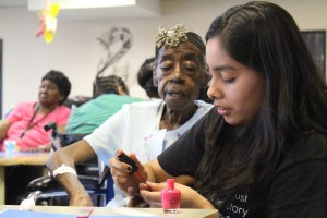 """Claudell Spraggins, 79, said she never had a manicure: """"It feels good to have someone do it for me."""""""