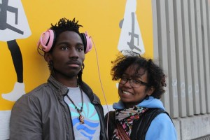 Artist and activist Sharon De La Cruz, right, with assistant Darius Davis, is making a difference.