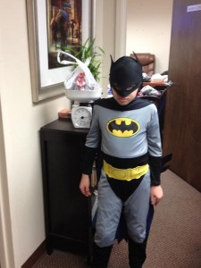 Batman, better known as eight-year-old Charlie, had his candy donation weighed.