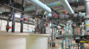 In the belly of the boiler room, hot water from the roof combines with cooler water destined for the pool.