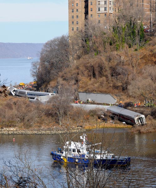 All seven of the commuter train's cars and its locomotive came off the tracks.  Photo: QPHOTONYC