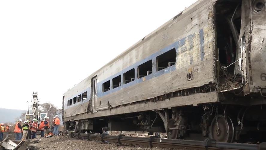 A damaged car.  <i>Photo: NTSB</i>