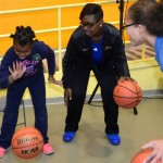 The entire team taught 35 youngsters of all ages on basic defense, dribbling, and other basketball skills.