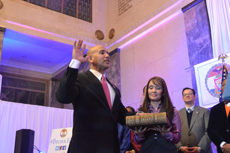 Bronx Borough President Rubén Díaz takes the oath of office at his inauguration ceremony.