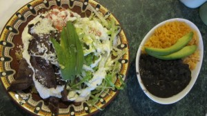 Chilaquiles are typically served with refried beans and rice – and avocado.