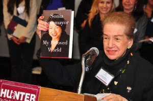 Founding member of 100 Hispanic Women Angela Cabrera holds up Justice Sonia Sotomayor's new memoir. Photo: QPHOTONYC