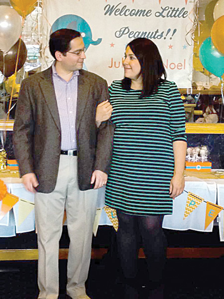 My husband and I celebrate our baby shower.