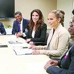 Among those the López sisters met with during a visit to Montefiore were Executive Vice President and Chief Operating Officer Dr. Philip Ozuah (second from left, in purple tie).