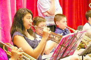 Daneyra and Nomar Mejía both play trumpet in UpBeat NYC's orchestra.