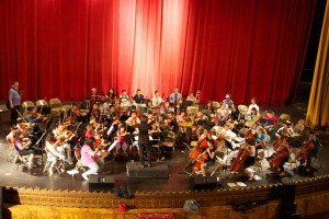 More than 150 children from youth orchestras will play as one.