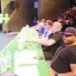 The panel of judges included hip hop artist John Brackett (foreground).