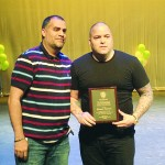 Manager Johnny Marines (right) received an award in recognition of his charity work.