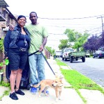 Jerry Fleetwood has lived in the neighborhood his whole life; he is here with Pam Crosson and their dog Blue.