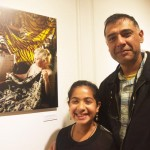 """It's fascinating,"" said photographer Adi Talwar, with his daughter Arushi; he stands beside his portrait of artist Ruth Marshall of Morris Park. Photo: S. Mazzocchi"