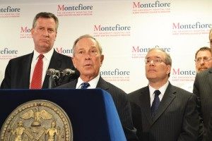 Mayor Michael Bloomberg stands flanked by Public Advocate Bill De Blasio (left) and Manhattan Borough President Scott Stringer (right) during a visit to Montefiore Medical Center, where he explained plans to significantly lower obesity rates.