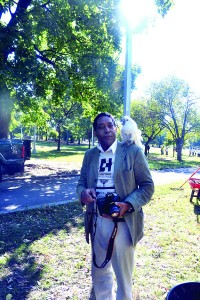 Guillermo Perez, a manager at Chestnut Holdings, poses with his pet bird(web)