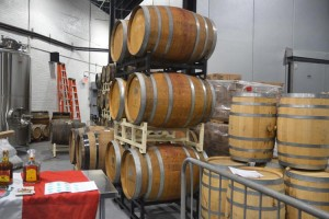The barrels are from purveyors Scorpion Mezcal and El Jimador Tequila.