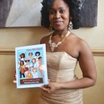 Published author Sulma V. Arzu-Brown shows off her work.
