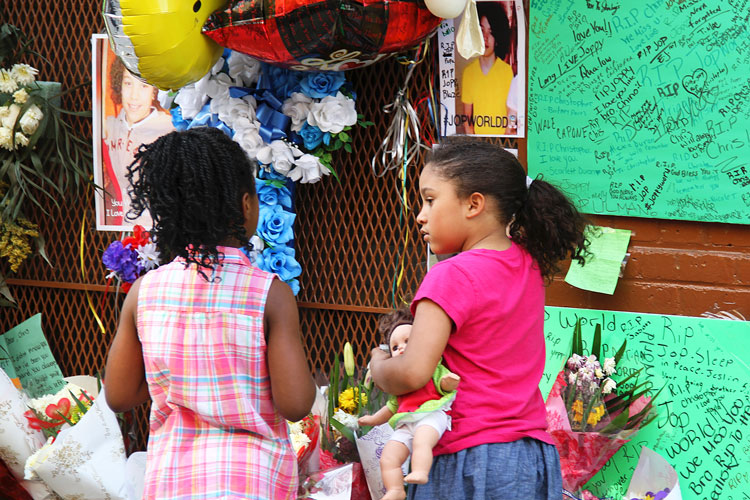 Young children stop by the memorial.  Photo: Catherine Fonseca
