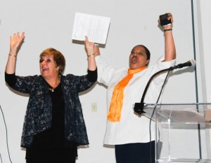 "Paula Gavin and Miriam Tabb ""raising the roof""."