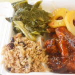 A selection of glazed honey wings, pineapple glazed ham, rice and beans and collard greens.