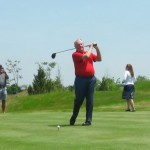 Golf legend Jack Nicklaus tees off.