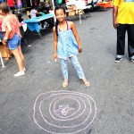 Jada Losada, 10 years old has fun with sidewalk chalk.