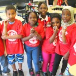 Campers at PS 79 show off their pedometers.
