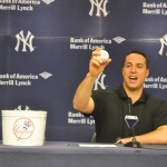 New York Yankees first baseman Mark Teixeira fields questions – and the ball.