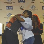 Jaylene is embraced by WWE personality Sheamus on stage.