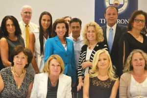 Hochul (center, in blue) with business owners.
