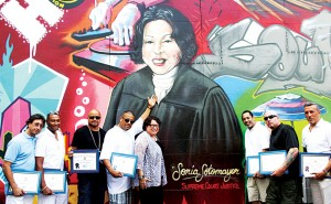 The artists with their subject, Justice Sonia Sotomayor.