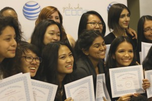 The graduates with their certificates.