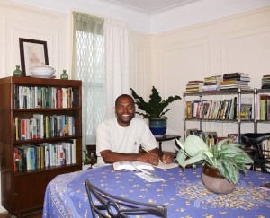 Historian Kristopher Morgan Powell at work in his living room.