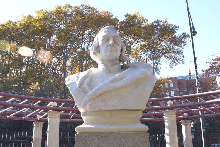 The bust of Christopher Columbus was vandalized.