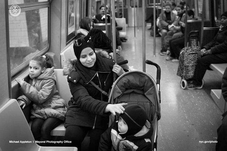 Eman rides the subway with her daughter, Souad, 6, and son Hassan, 2.