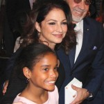 Gloria and Emilio Estefan, creators of Get on Your Feet, with a young fan.