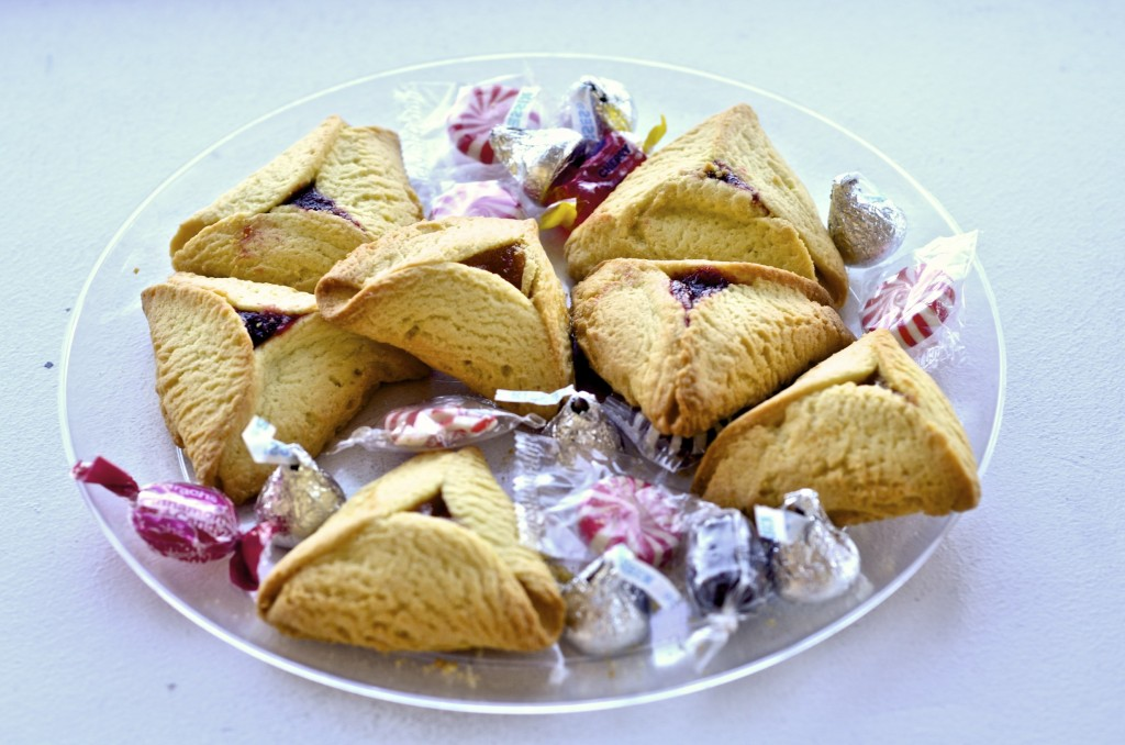 These sweet triangular pastries are called Hammentaschen, and are intended to be representative of the hat of Haman, the villain in the Purim story.